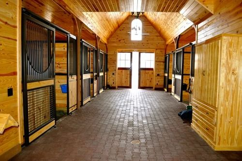 High Stall Front 20 Stall Design With Bar Top Wood And Crosshatch Mesh Bottom Euro Style Center And Bo Horse Barn Plans Horse Barn Designs Dream Horse Barns