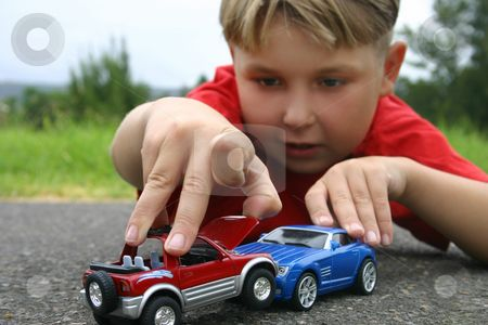 toy kids playing with toy cars