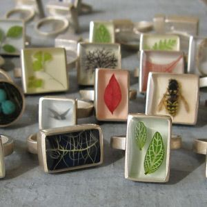 a big fan of Fernworks (I own that leaf ring bottom right, and some other goodies). She makes beautiful jewelry out of nature.  If you can catch her at a craft show, it's a delight to see all of her pieces together.