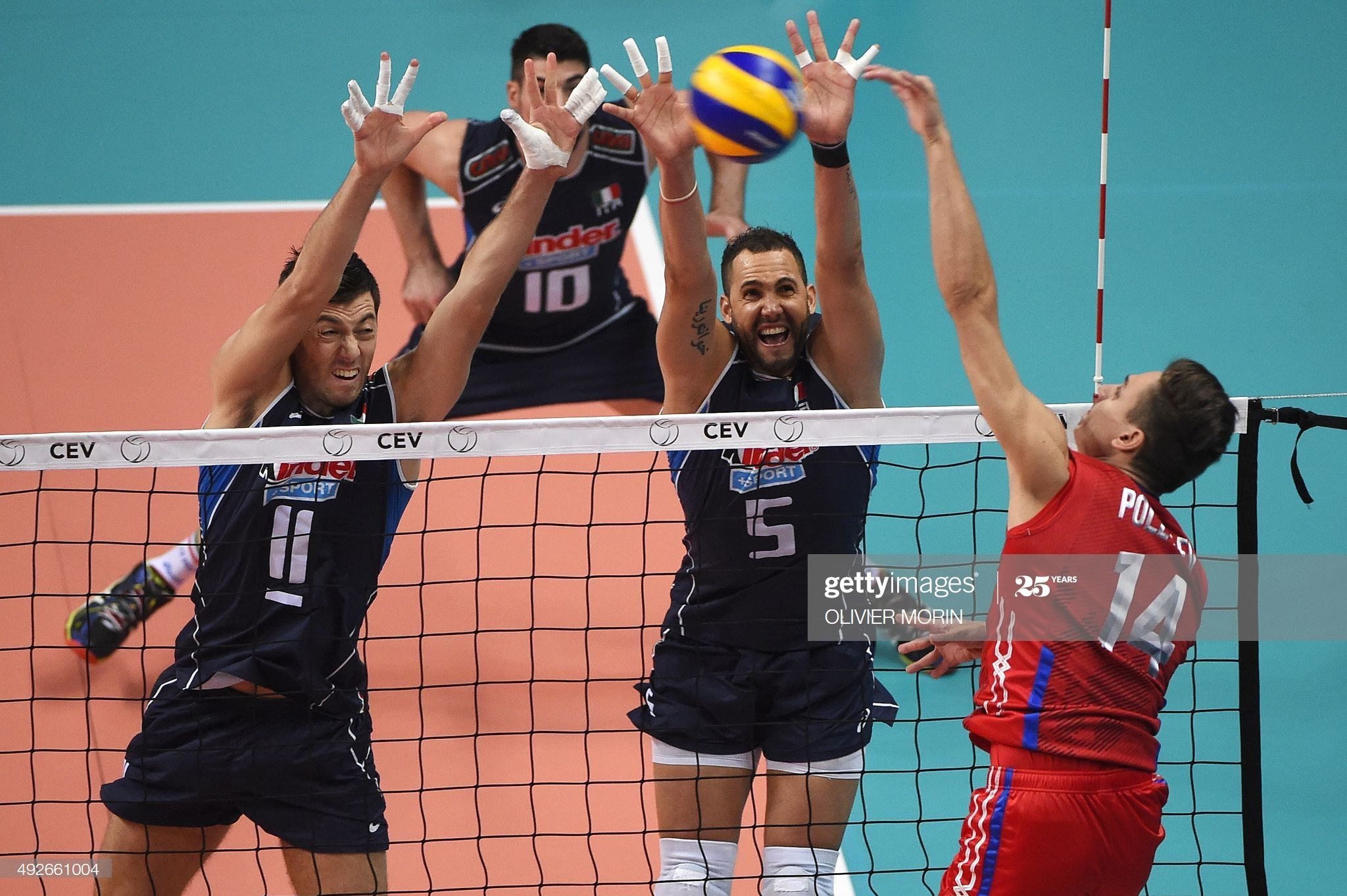 Russia S Victor Poletaev Hits The Ball In Front Of Italy S Osmany In 2020 Mens Volleyball Volleyball Victor