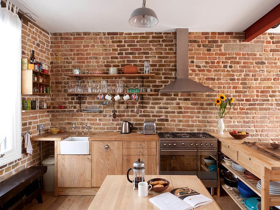 Contemporary Kitchen In London With Brick Walls And Wooden Workstation