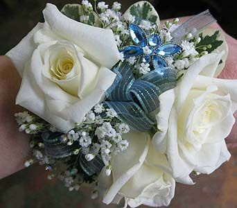 Whtie Rose wrist corsage with butterfly bling.