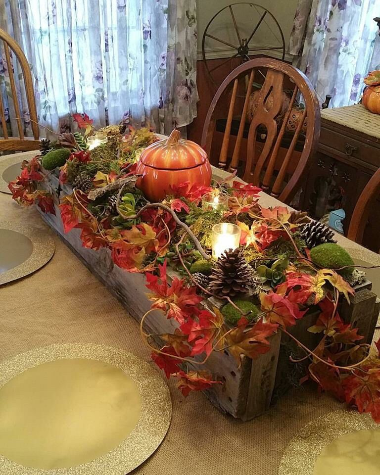 Thanksgiving table centerpiece. Ammo box, moss, stones, twigs, bark, succulents, pine cones, candles, & a ceramic pumpkin pot!