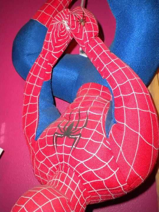a spider was crawling on the stuffed Spiderman