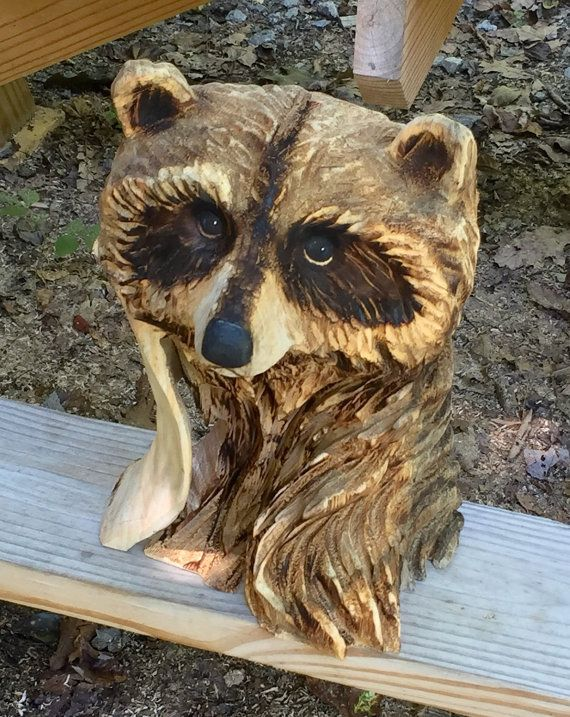 Raccoon chainsaw carving wood carving carved wood sculpture a