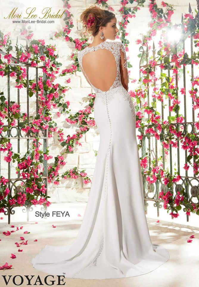 Style FEYA  SATIN BACK CREPE WITH CRYSTAL BEADED VENICE LACE APPLIQUES Available in White, Ivory  Precio: $ 2.252.250 Pesos Colombianos  Precio: $ 1.023.00 Dólares Americanos