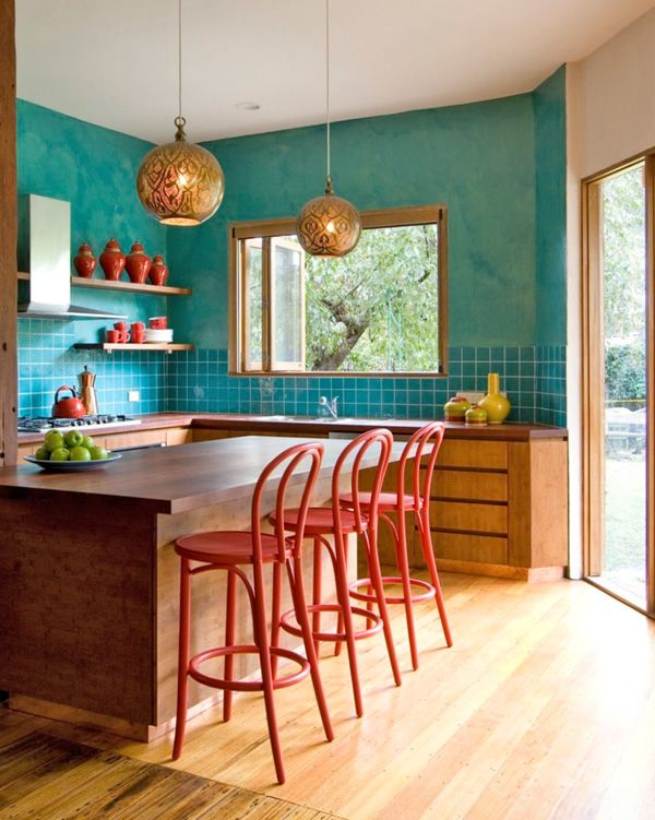 Colorful tiled kitchen red stool