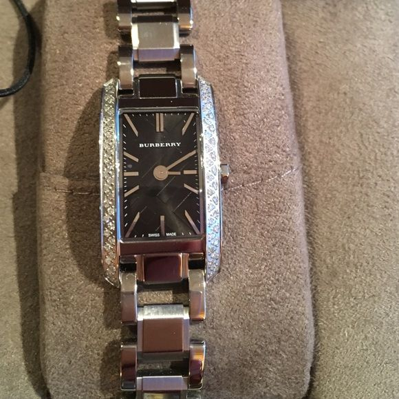 DIAMOND BURBERRY WATCH NO TRADE GORGEOUS BURBERRY DIAMOND WATCH. I WORE IT 3 times HAD THE BAND ADJUSTED TO FIT MY WRIST BUT HAVE THE EXTRA LINKS Burberry Accessories Watches