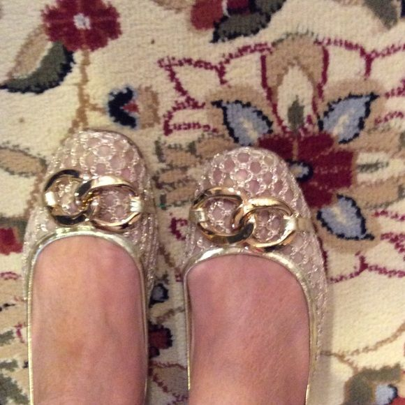 Authentic Juicy Couture shoes These are gold JC flats. The front and sides are mesh and the back is gold leather.  The front has 2 gold metals interlocking rings... They were made in Italy and are in almost  brand new condition. Juicy Couture Shoes Flats & Loafers
