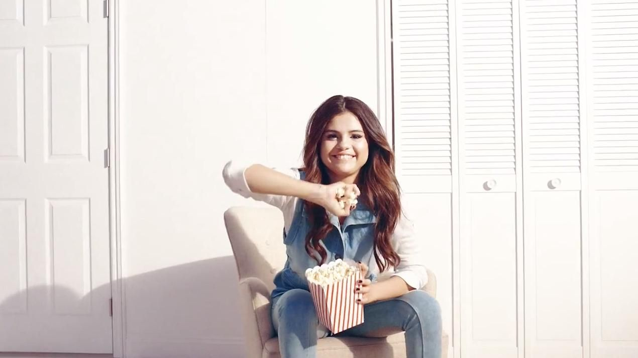 Here's a screenshot of Selena Gomez on the set of her photo shoot for her Dream Out Loud collection
