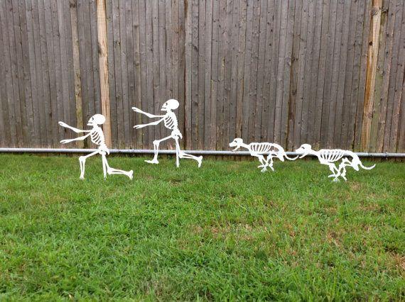 Halloween Running Yard Skeletons - dog skeletons chasing person