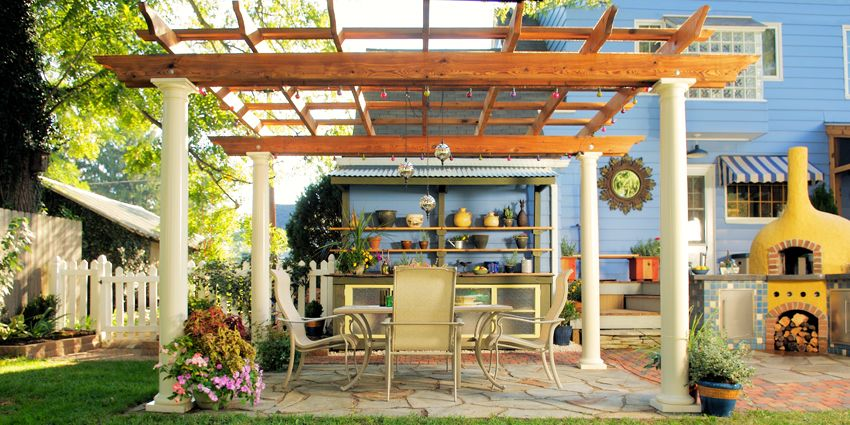 This cedar-covered pergola covers the dining area at the