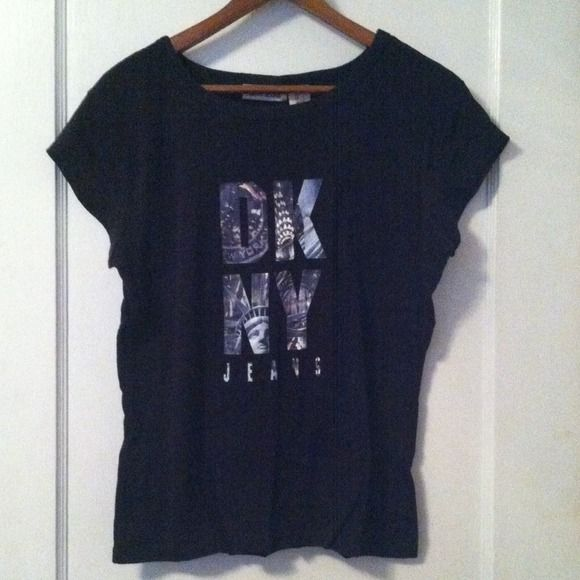 DKNY Jeans Black Cityscape Tee DKNY tee is black with a screen printed cityscape graphic in the logo. Size Large. Excellent condition. Machine wash. DKNY Tops