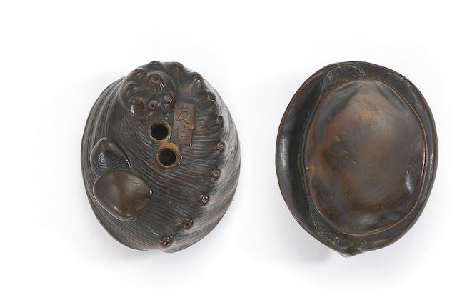 A wood netsuke of an awabi (abalone) By Tomonobu of Nagoya, Edo period (19th…