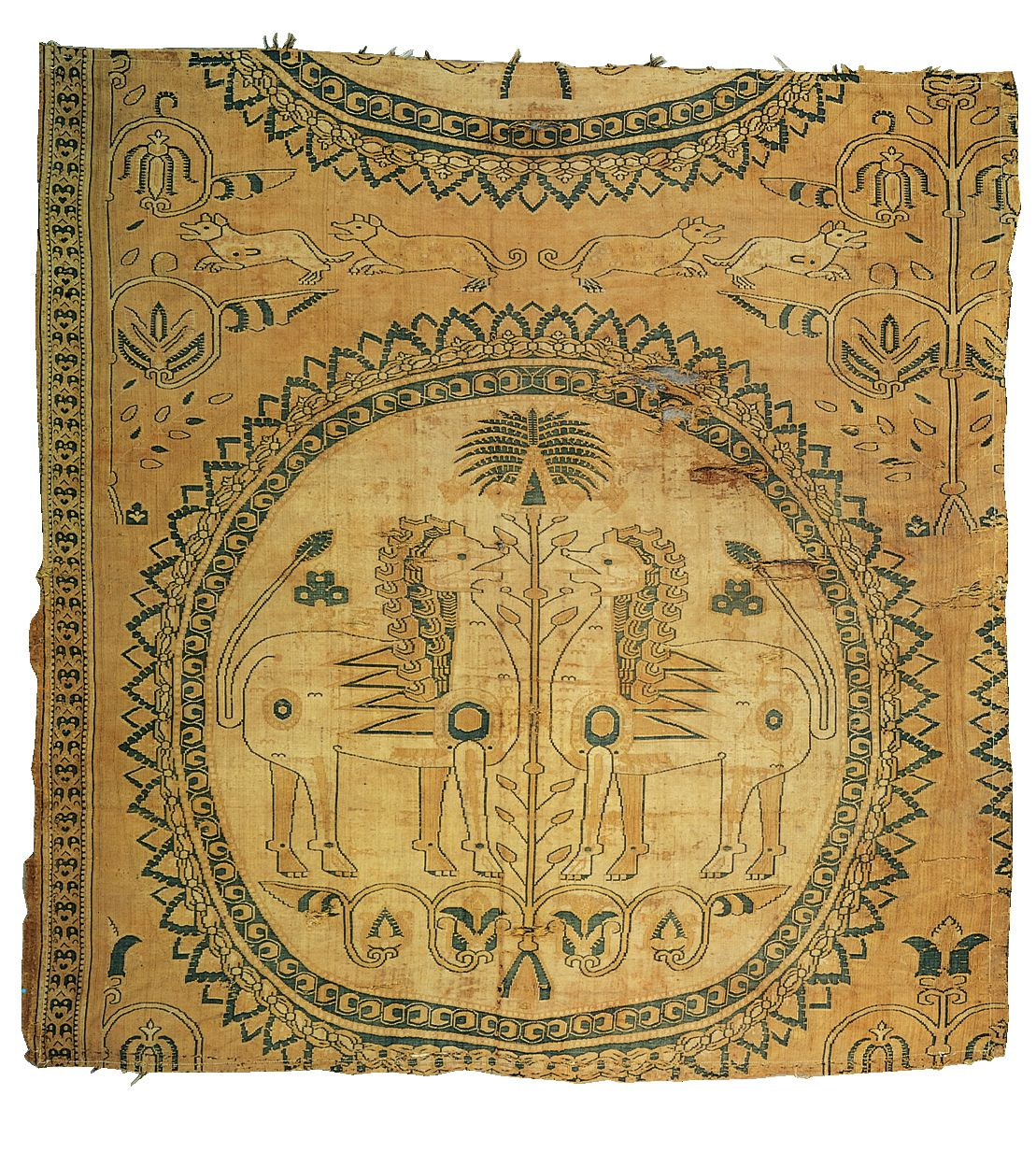 [Unknown,Confronting lions and palm tree,fragment of a textile said to be from Zandana, eighth century.Silk compound twill,Islamic art.] Silk textiles and wool carpets are among the glories of Islamic art. Silk textiles were probably from China.The design perhaps based on Sasanian models. Such zoomorphic motifs are foreign to the decorative vocabulary of mosque architecture, but they could be found in Muslim households (Kleiner 350).