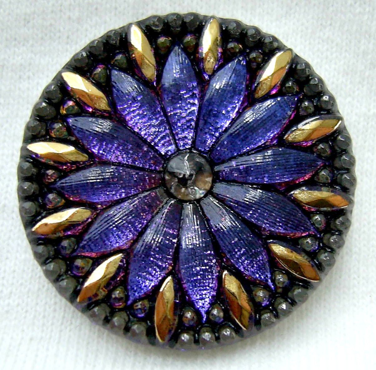 This beautiful, mirrored clear glass button has a pretty daisy motif that radiates blue & violet metallic hues. Description from etsy.com. I searched for this on bing.com/images