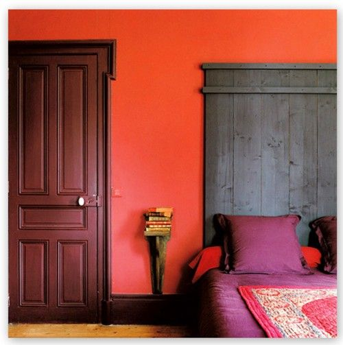 Orange Accent Wall Purple Bed Linens I Like The Wooden Sconce