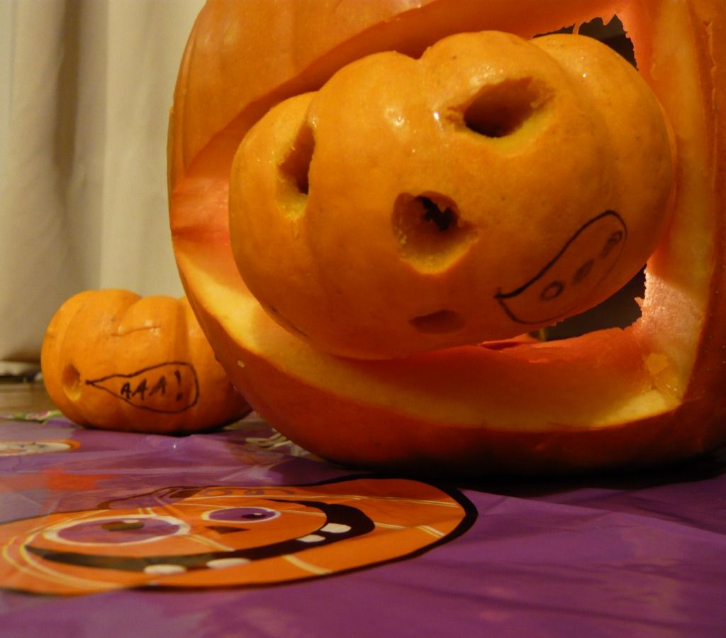 Simple & cute, commonly known and liked pumpkin carving idea: big pumpkin  eating a little one.