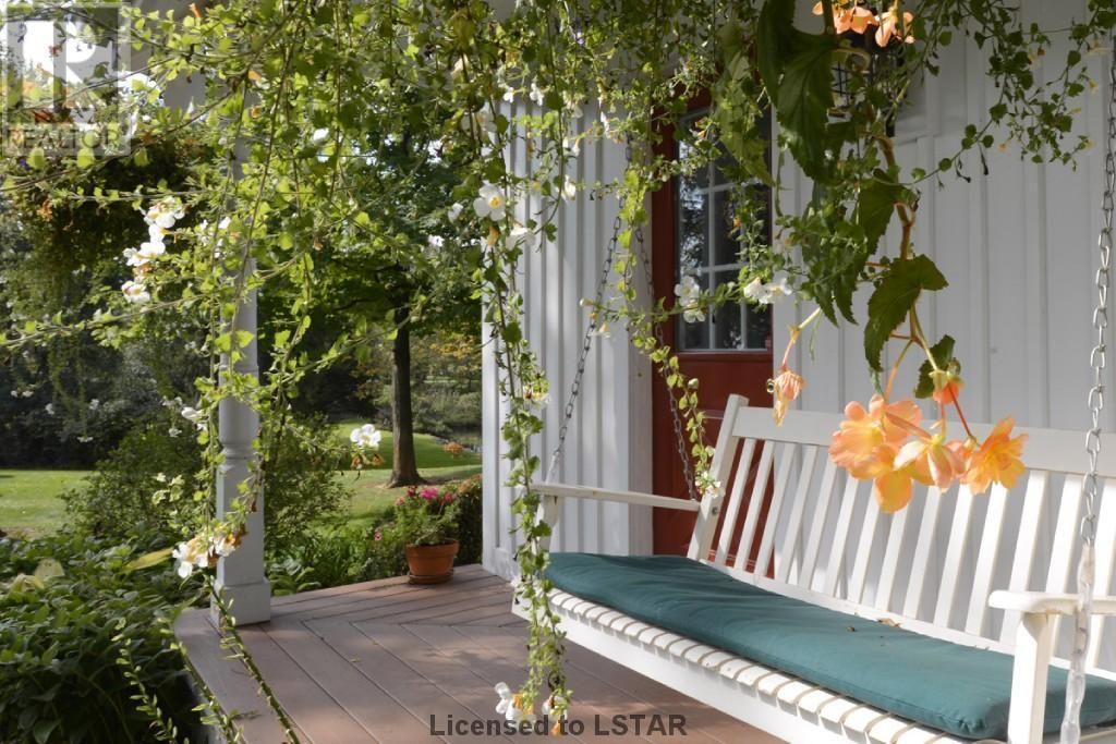 snug cottage porch swing cottage inspiration cottage on porch swing ideas inspiration id=36288