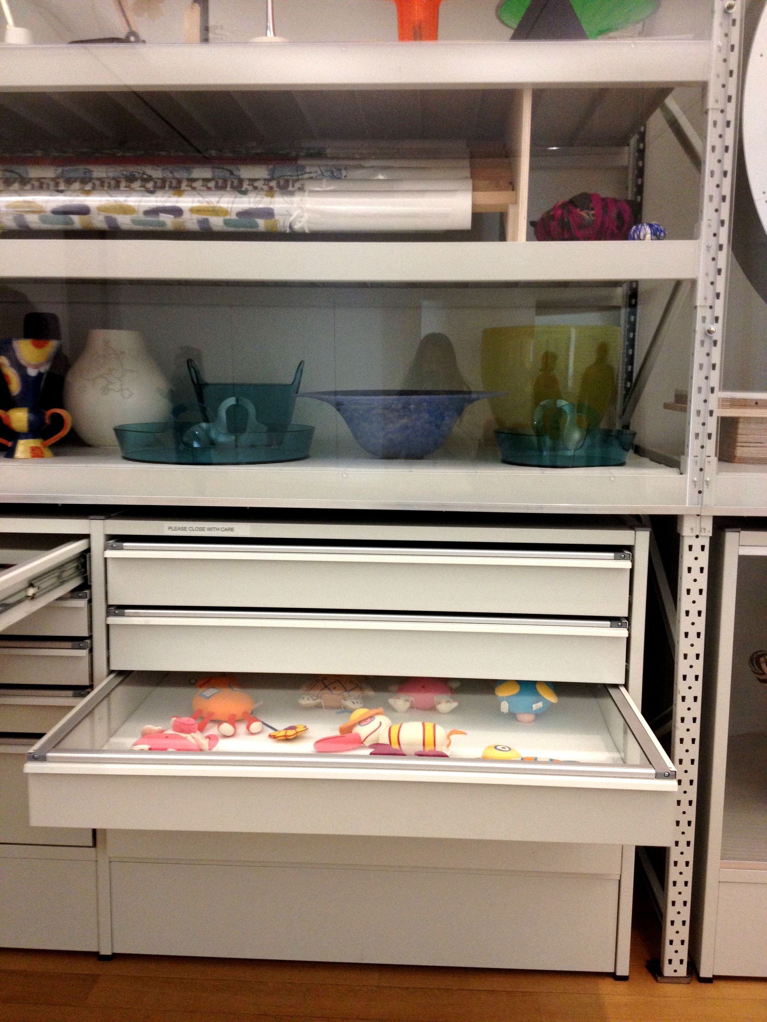 tidy and functional display storage different sized drawers