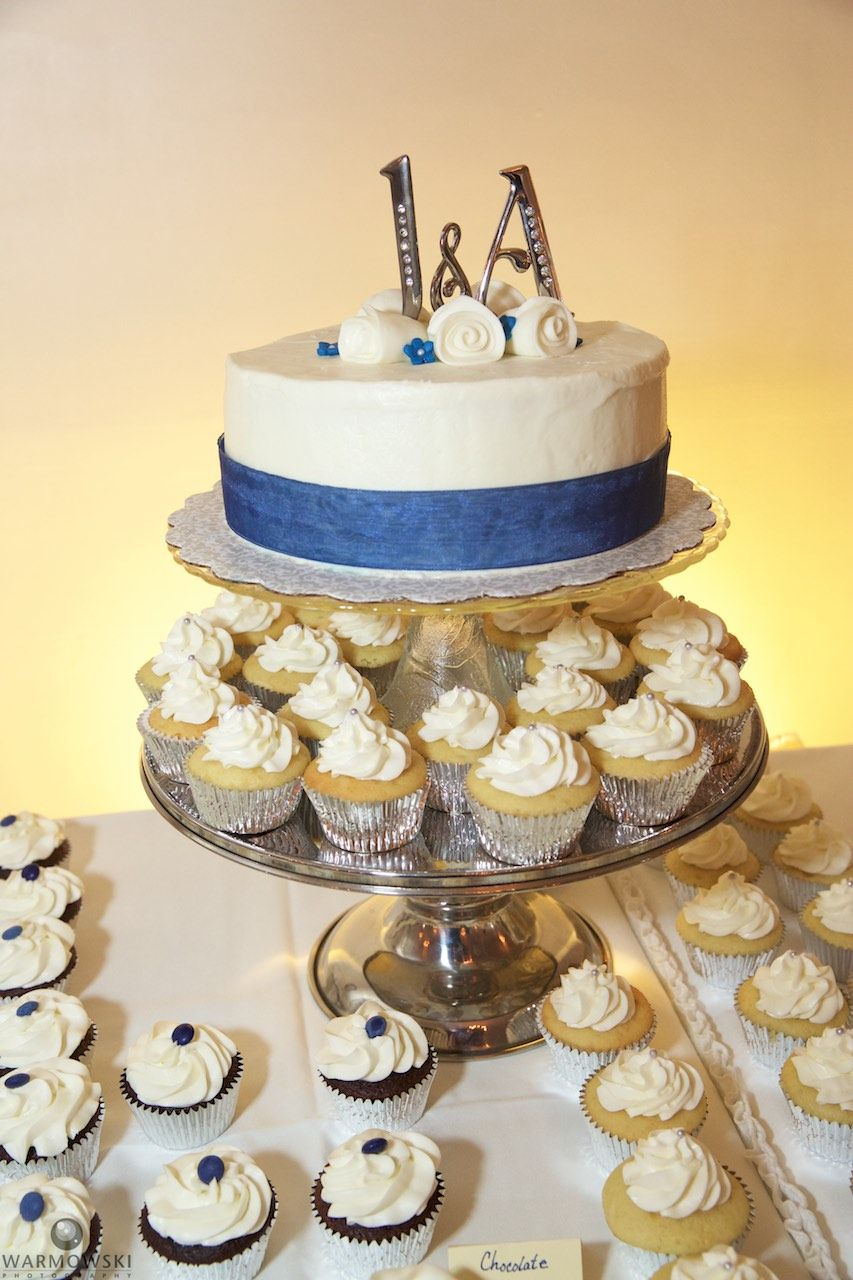 Cupcakes and cake for wedding dessert table