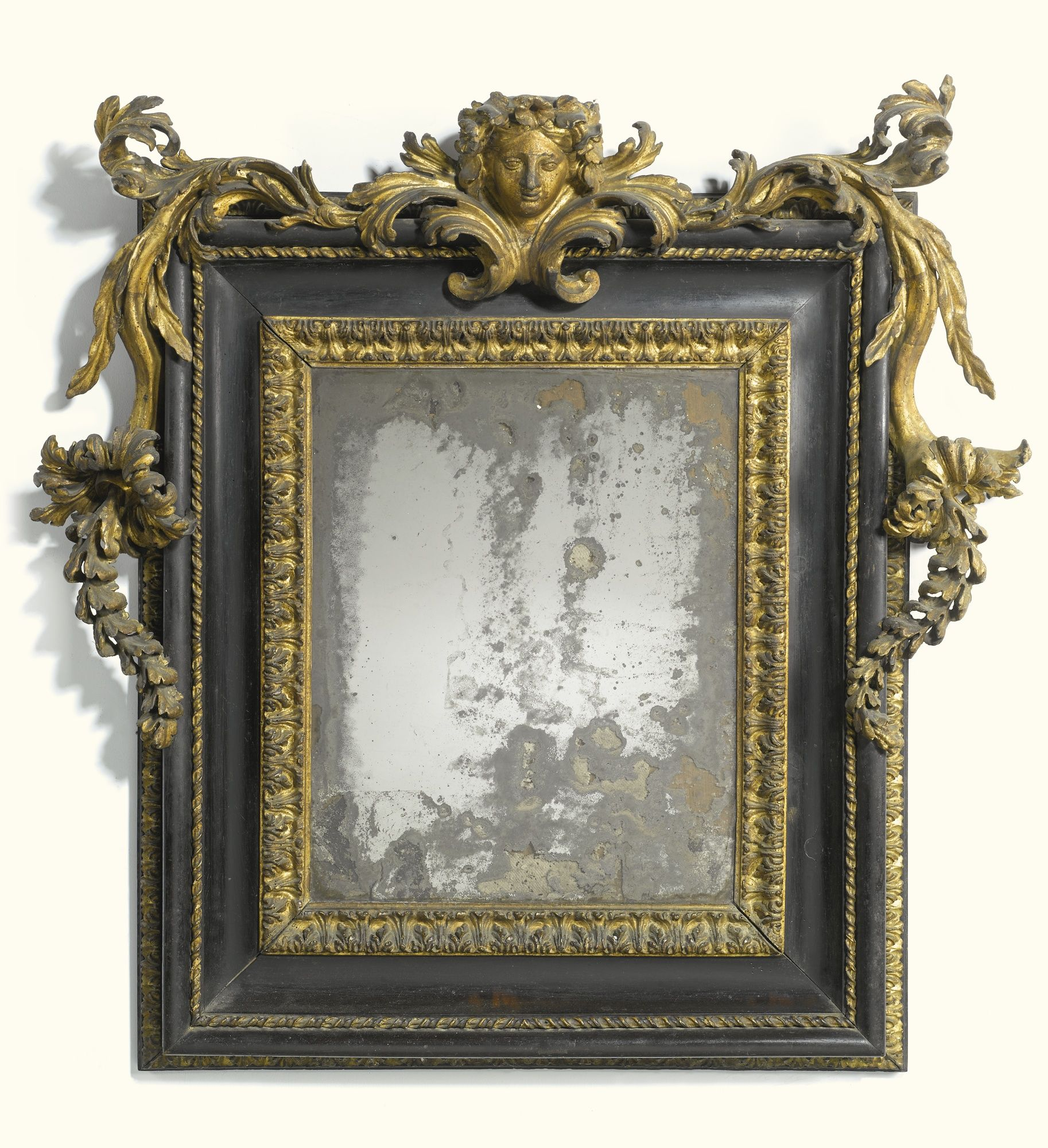 An Italian carved giltwood and ebonised mirror, Roman, late 17th ...