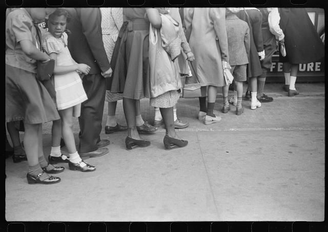[Untitled photo, possibly related to: Children in front of moving picture theater, Easter Sunday matinee, Black Belt, Chicago, Illinois]