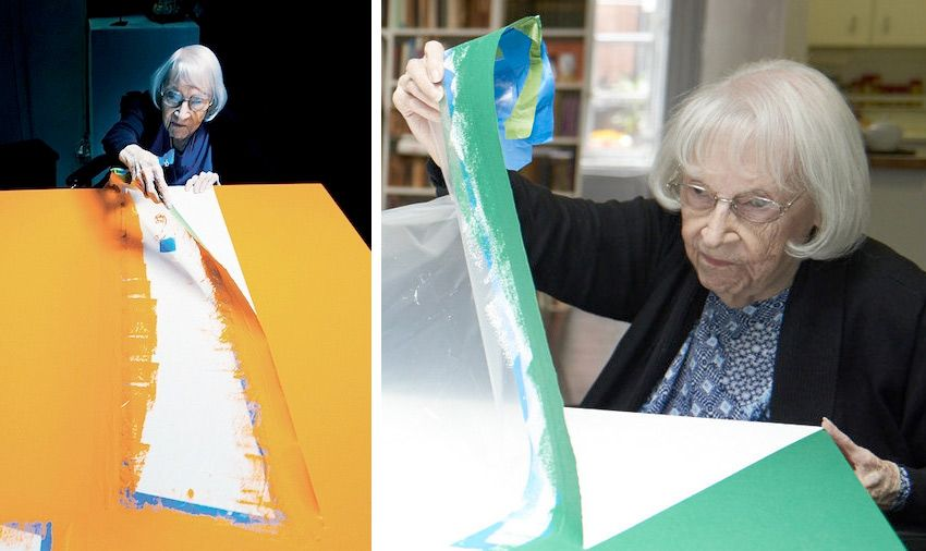 Carmen Herrera in the studio ... not a typical shot of an artist at work - peeling tape rather than painting?