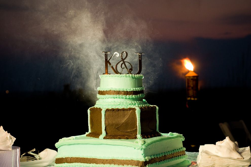 Epic wedding cake, complete with smoking entrance  also, tiki torches!