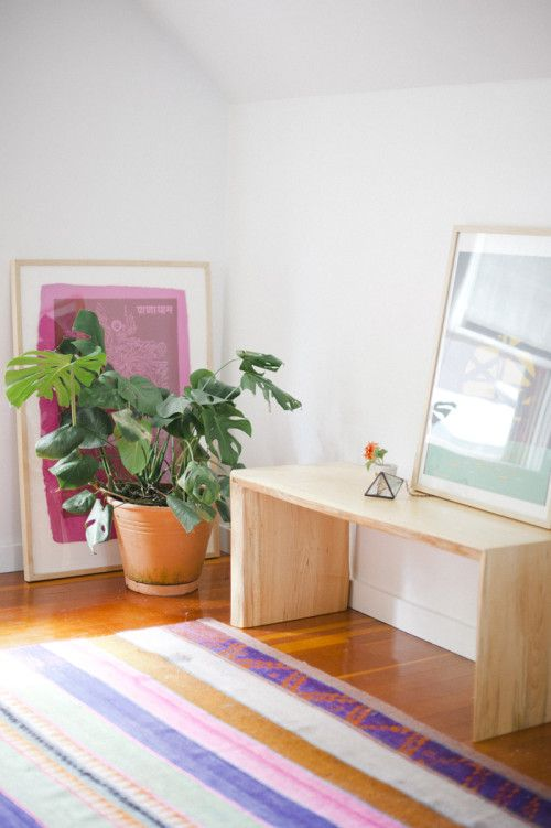 Is the pink print playing hide and seek? Because I see it cowering behind that plant. Stop leaning frames on the walls! It marks up the walls, doesn't do the frame any favors, and looks half-assed. Just hang the frame already.