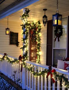 Deck Railing Garland Strung With Lights Around The Porch Railings Bayer Built Woodw Front Porch Christmas Decor Christmas Front Porch Christmas Porch Decor