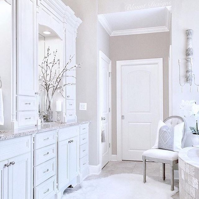 I'm always pinning bathroom inspiration because I'm not a fan of my own but my friend Deborah of @blountdesigns has everything my dreams are made of. Serene, bright, and glam with all the storage I could ever hope for 😍 If this were mine, I think I would add a mini fridge and pull a desk up to that chair as never leave 😂 Anyone else have bathroom envy?? #followfriday #ff