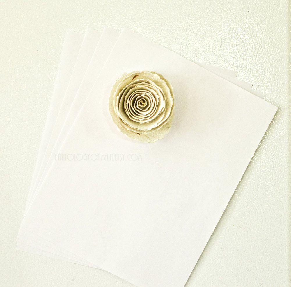 Handmade Paper Flower Magnet - Shabby Chic and Eco Friendly Fridge Decor. $5.00, via Etsy.
