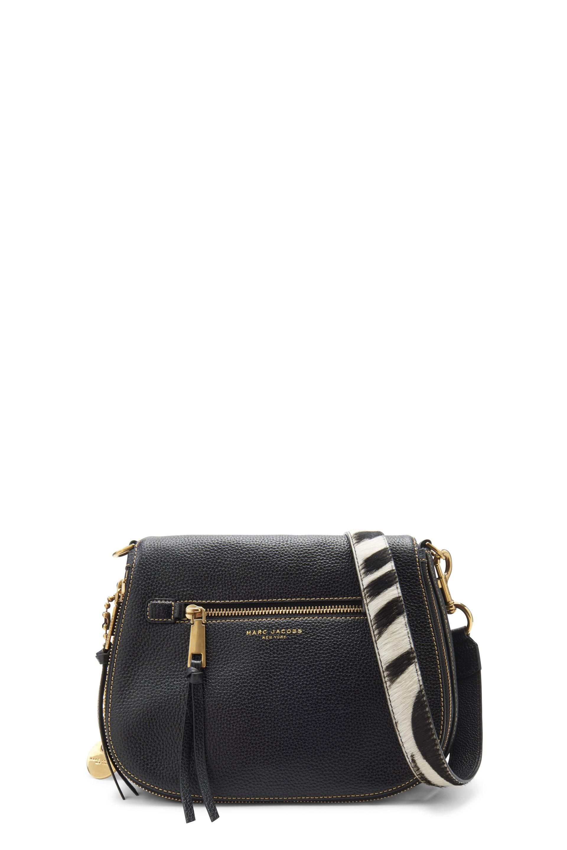 8effe0b7c8e The Marc Jacobs Recruit Saddle Bag with Guitar Strap is crafted from cow  leather and features polyester interior lining. The Saddle Bag has a dome  shape and ...
