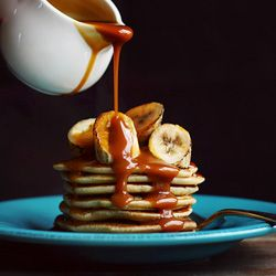 Coconut pancakes with grilled bananas and salted caramel rum sauce.