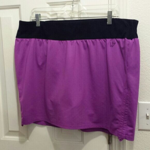 Lane Bryant plus size purple skorts 18/20 Just in time for spring! Purple skorts from Lane Bryant. The under shorts are like soft cotton lycra sport shorts. The outer skirt rouches on the side if you want. These are great for the gym! Lane Bryant Skirts