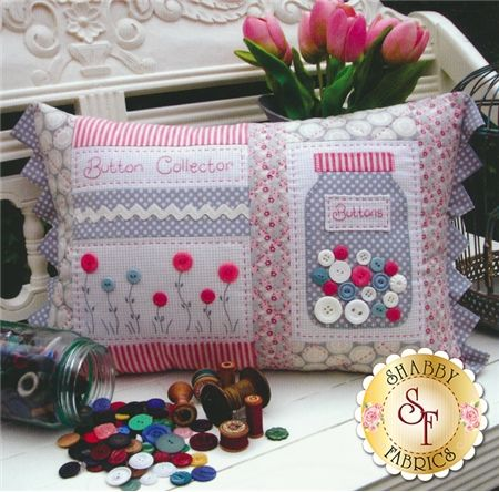 """The Rivendale Collection - Button Collector: This charming pattern is a part of The Rivendale Collection by Sally Giblin. Pattern includes instructions for stitchery, instructions for appliqué, and instructions for cushion. Finished size is 13 1/2"""" x 22""""."""