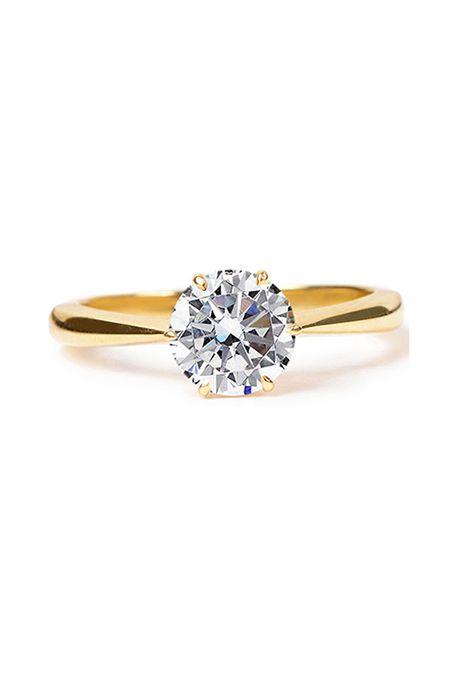 a8e8732c3f5 Brides.com  . 18K yellow gold solitaire diamond engagement ring