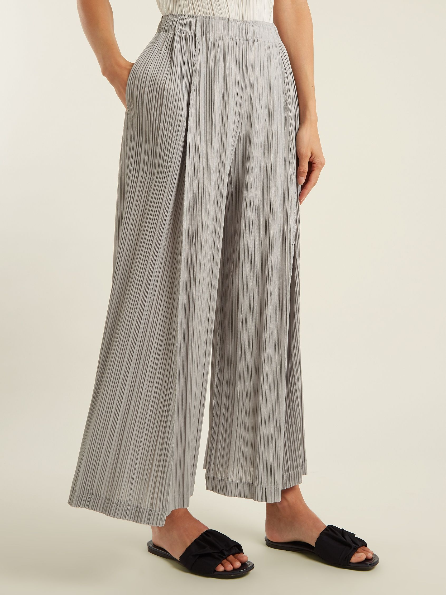 Click here to buy Pleats Please Issey Miyake Pleated wide-leg trousers at  MATCHESFASHION. c3df29a305ef9