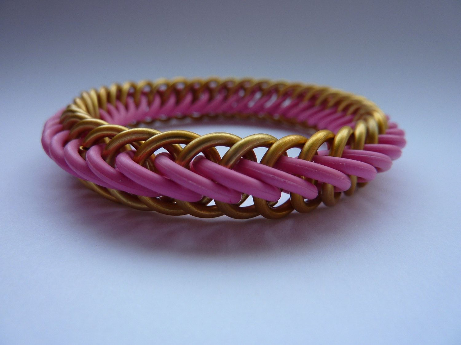 Chainmaille bracelet stretchy half persian design in pink and gold