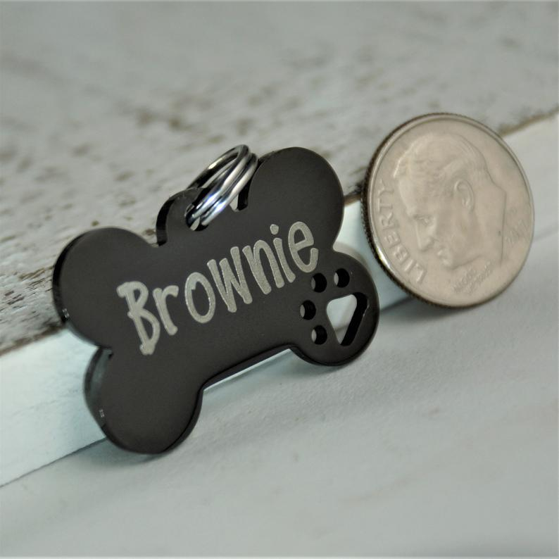 Personalized Small Dog Tag With Cutout Dog Paw Dog Bone Tag Etsy Dog Bone Dog Tags Small Dogs