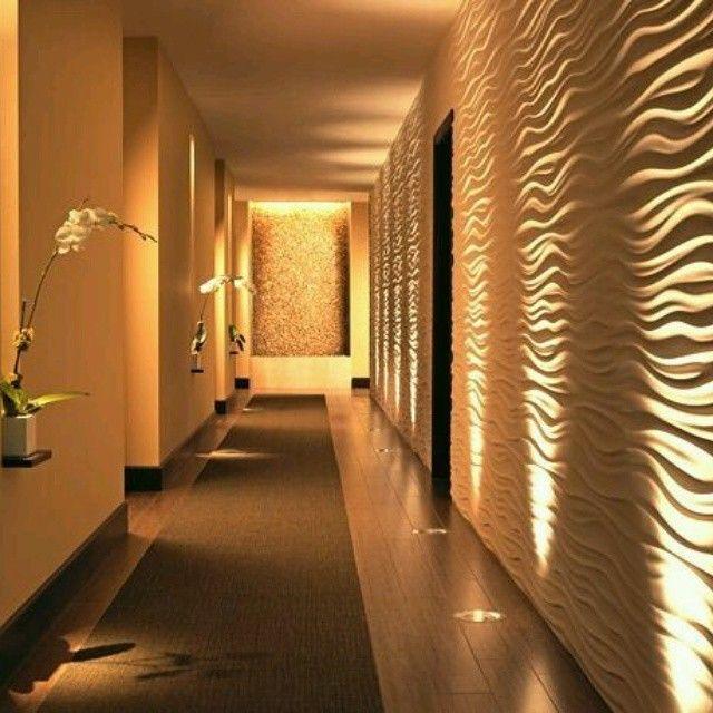 Destacado dise o de iluminaci n y revestimientos en - Decoracion para pasillos ...