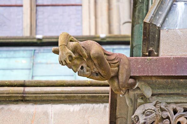 Another man gargoyle in great pain at the Nidaros Church in Trondheim, Norway