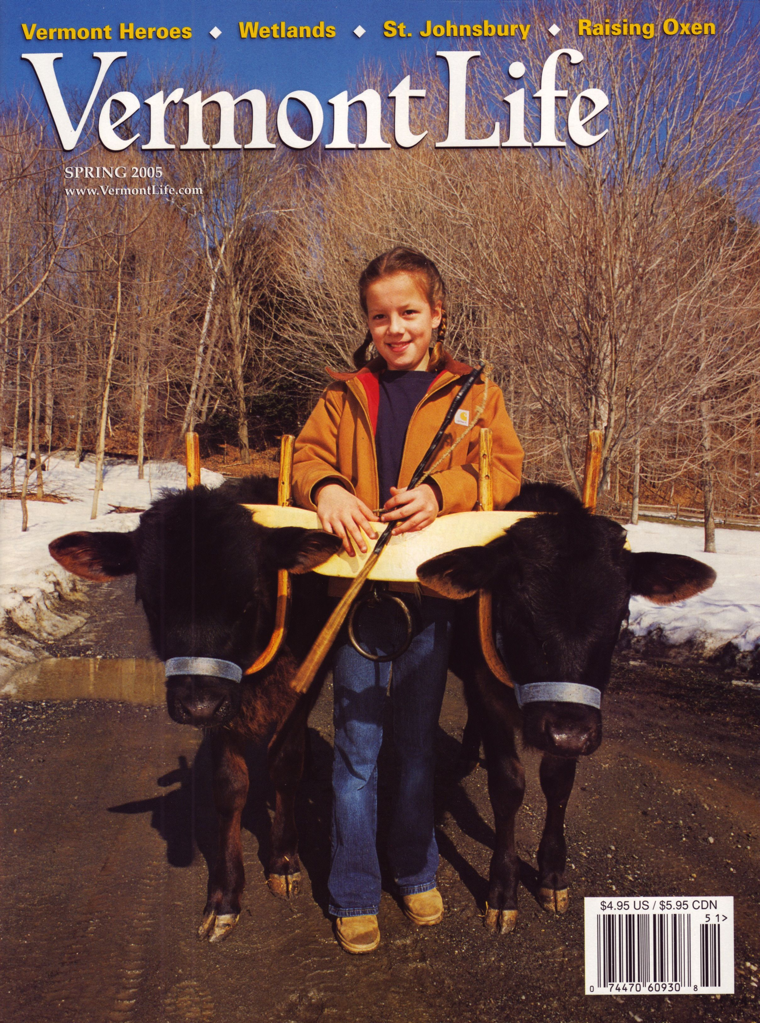 Spring 2005. Putney's Emily Wilson and her oxen-in-training, Pete and Bob, photograph by Kevin Bubriski.