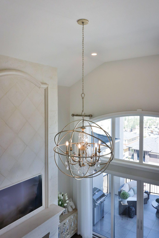 Brushed Nickel Orb Chandelier Over The Living Room Orb Chandelier Lighting Lighting Showroom