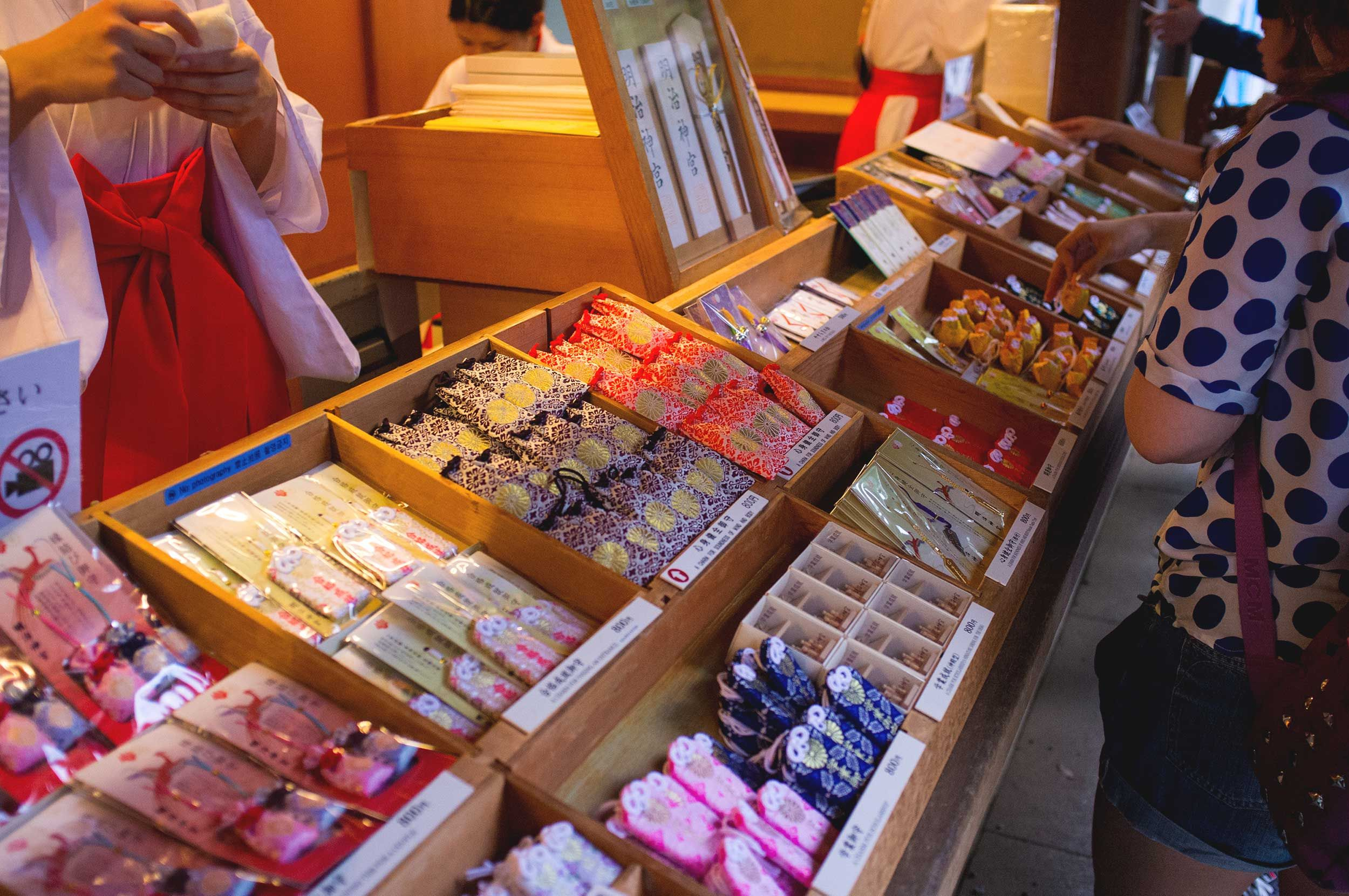 Photo taken as part of the blog 15 Days in Japan by Nuno Coelho SantosThis is a stall selling Omamori. These amulets are meant to be bought for oneself or for a relative, and you must write a wish or a prayer on a piece of paper and place it inside the Omamori. After a year you must replace your Omamori to ward off bad luck.