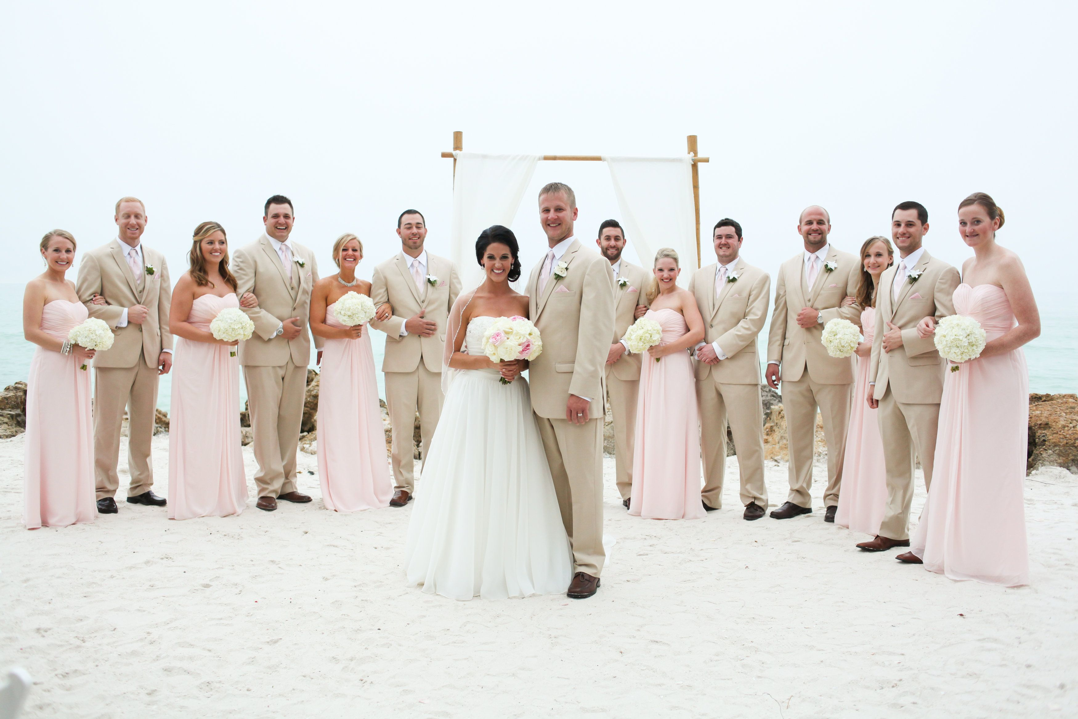 Blush Bridesmaids And Tan Groomsmen Suits Blush Beach Wedding