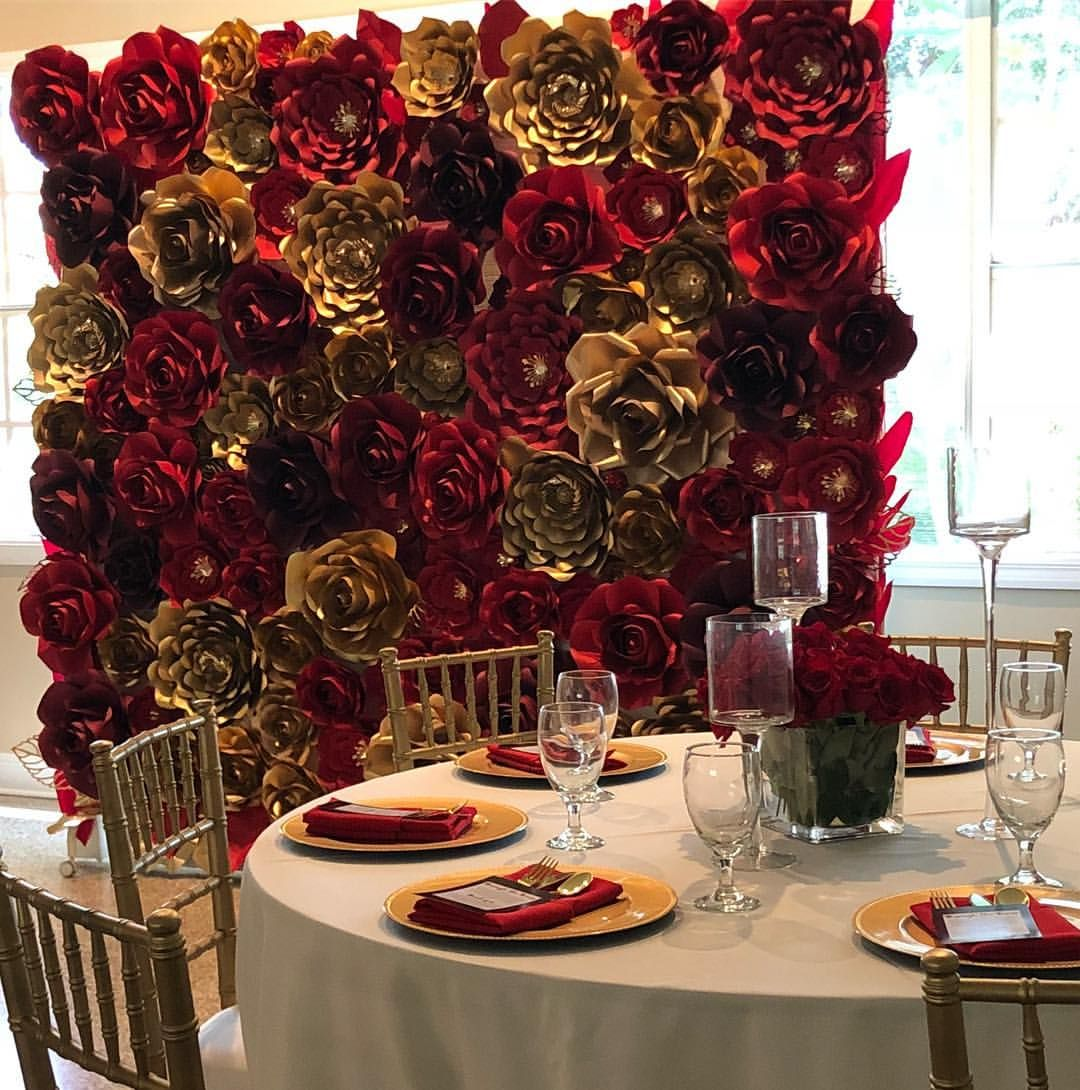 Red and gold paper flowers for a beautiful wedding backdrop