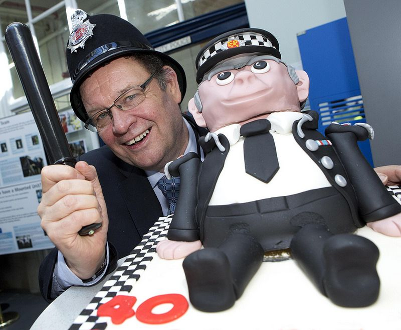 Deputy Police and Crime Commissioner Jim Battle and a very special cake. Greater Manchester Police marked its 40th anniversary on April 1 with celebrations across the Force.  A number of community events took place around the area to celebrate the special occasion. Bake sales will also took place to raise money for the Cash for Kids, a local charity for sick and underprivileged children run by Key 103 radio. The GMP Police Museum joined in by hosting their own festivities.
