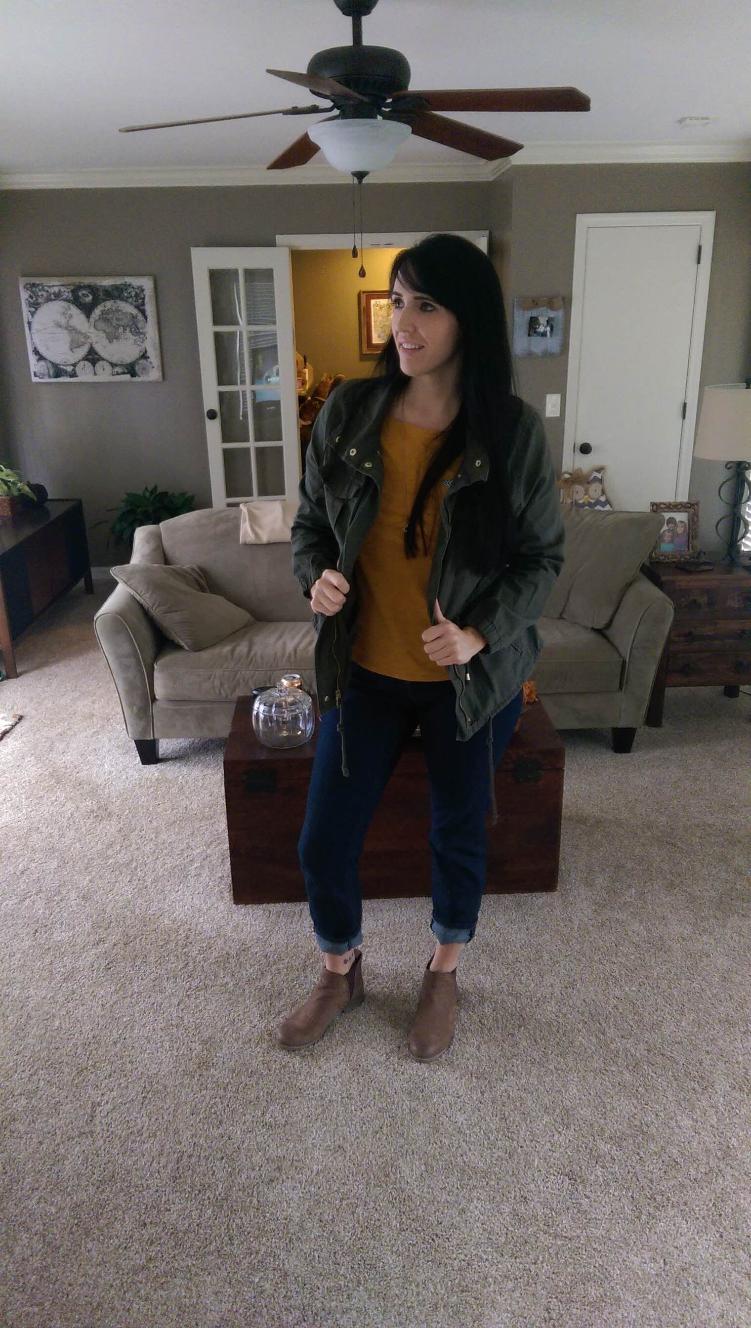 Mustard top from Anthro, forest green utility jacket from Old Navy - paired with cuffed jeans and brown Steve Madden booties.